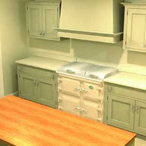 A luxury, bespoke kitchen during fitting with duck egg blue freestanding units and an aga.